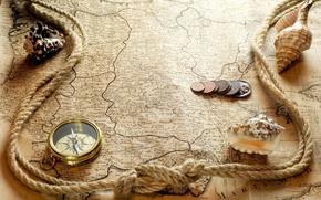 monete, bussola, mappa