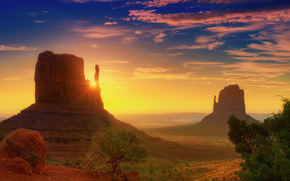 Monument Valley, Utah, dawn, rays, clouds, desert