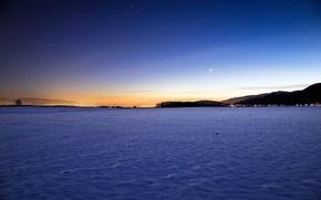 Winter, sunset, lights on the horizon