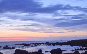 wieczr, zmierzch, zachd soca, niebo, chmury, morze, ocean, wybrzee, kamienie, latarnia morska, w oddali