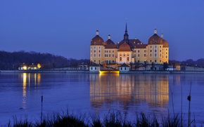 Germany, Saxony, Moritzburg, castle, evening, lights, light, water, reflection