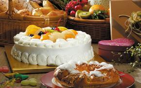 стол, тарелка, коробки, корзины, десерт, сладкое, торт, пирог, фрукты, крем, апельсины, вишни, черешни, конфеты, киви, виноград, хлеб, батоны, злаки