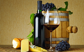 table, mat, barrel, bottle, goblet, wine, red, grapes, cheese, bread, baguette, leaves