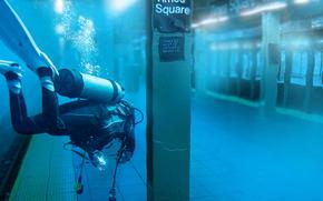 diver, metro, new york, times square, hurricane, sandy