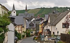 Германия, Фельденц, городок, улочка, дома, холм, поля, небо