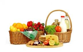 basket, bread, cheese, vegetables, fruit, milk, lemons, tomatoes, onion, eggs, radishes, paprika