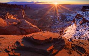 sunrise warmth from mesa, canyonlands national park, utah