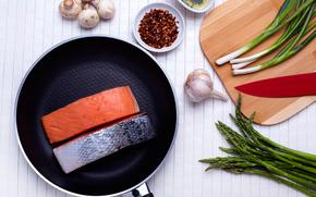 FISH, garlic, spices, greens
