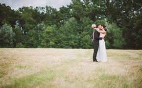 bride, kiss, suit, field, grass, groom, dress