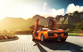 ламбо двери, брусчатка, ламборджини, оранжевый, солнце, мурселаго, блик, Lamborghini, цветы, ламборгини, горы, открытые двери