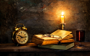 Time to turn in, watch, old books, candle